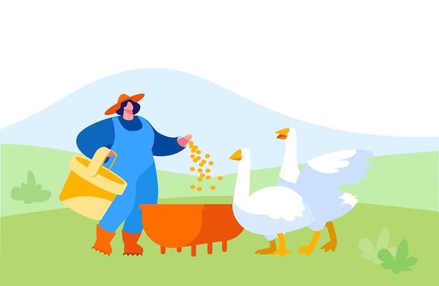 Молодая женщина в рабочем халате кормит гусей на природе