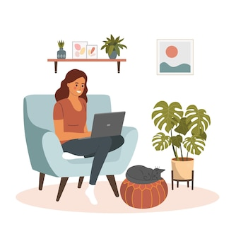 젊은 여성이 편안한 의자에서 휴식을 취하고 노트북을 사용하고 있습니다.