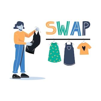 Молодая женщина делает покупки, чтобы поменяться партией. девушка в черном платье на вешалке. надпись swap.