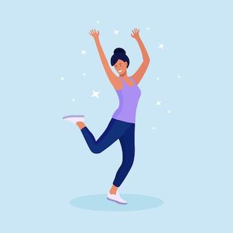 若い女性がジャンプします。幸せな前向きな女の子がジャンプして喜びを表現します。勝利、成功を祝う。笑って笑っている学生