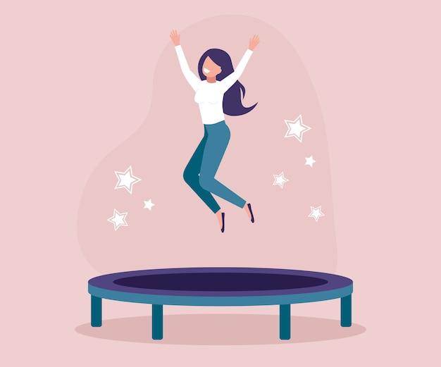 トランポリンでジャンプする若い女性。