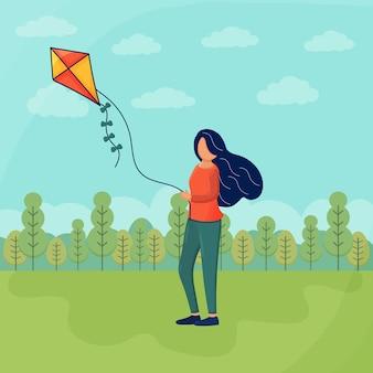 젊은 여자 발사 연 야외 소녀 바람 장난감 휴가를 재생