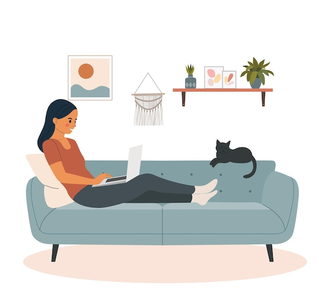 Young woman looking into a laptop and lying on sofa in the living room.