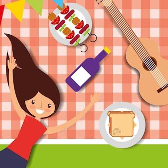 ピクニックのテーブルクロスに横たわっている若い女性