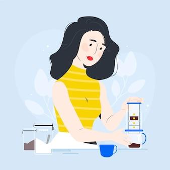 Giovane donna che fa il caffè a casa