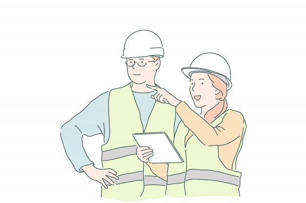 Young woman master businesswoman explains to builder foreman instructions and requirements.