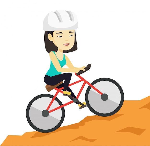 山を旅する自転車の若い女性。