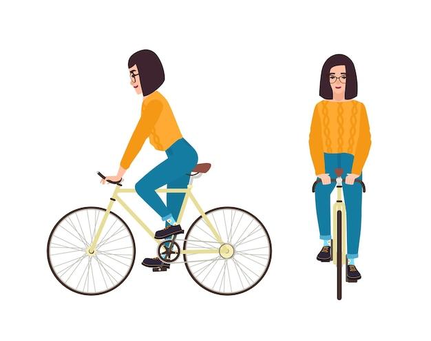 自転車に乗ってカジュアルな服を着た若い女性または女の子。自転車でジャンパーとジーンズを着ている平らな女性の漫画のキャラクター。白い背景で隔離のペダリングサイクリスト。ベクトルイラスト。