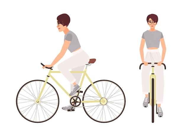 自転車に乗ってスポーツウェアに身を包んだ若い女性または少女。自転車でカジュアルな服を着ている平らな女性の漫画のキャラクター。白い背景で隔離のペダリングサイクリスト。カラフルなベクトルイラスト。
