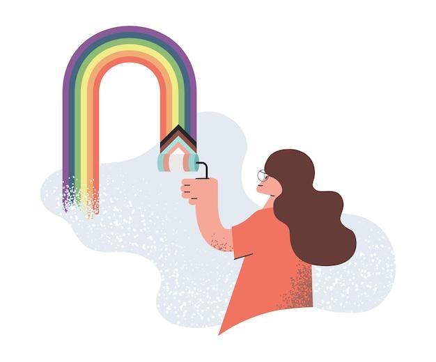 虹色の笑顔の女の子の描画で壁を描く若い女性