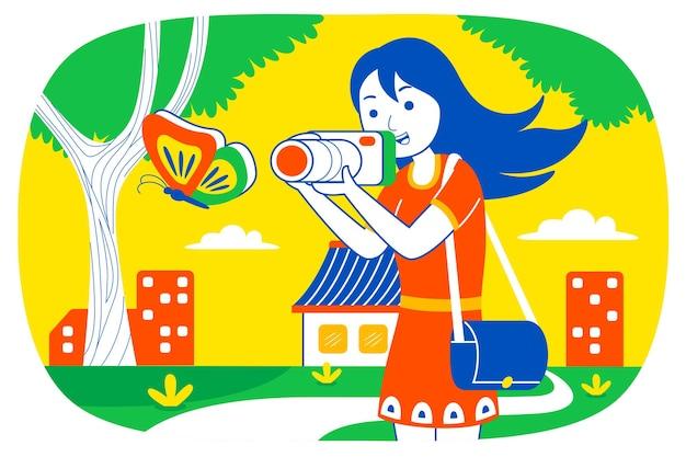Молодая женщина фотографирует бабочку в парке.