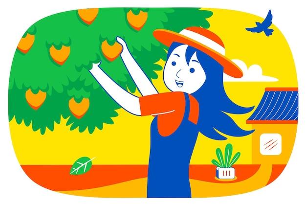 若い女性は庭で果物を選びます。