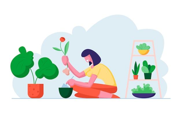 美しい温室で鉢に花を植える若い女性