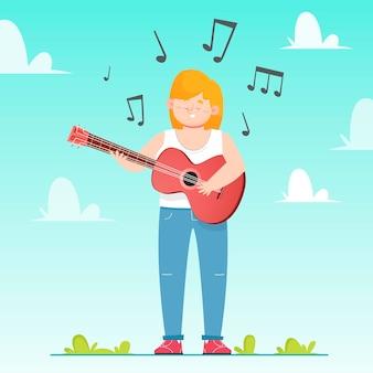屋外でギターを弾く若い女性