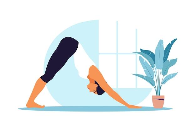 若い女性はヨガを練習します。肉体的および精神的な実践。