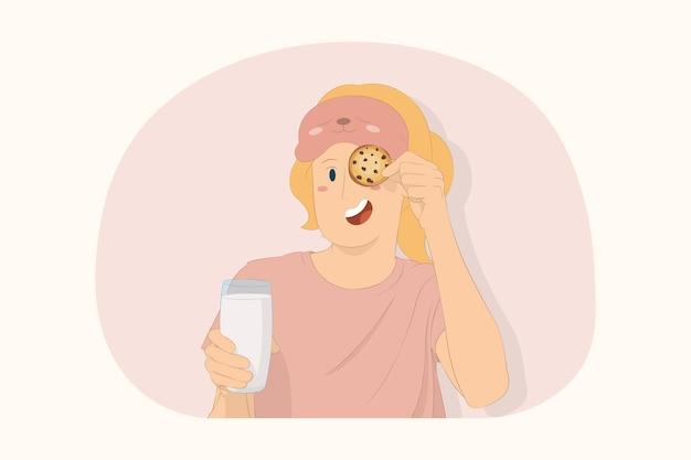 집에서 휴식을 취하는 젊은 여성이 쿠키 개념으로 우유 덮개 눈을 잡고 있다