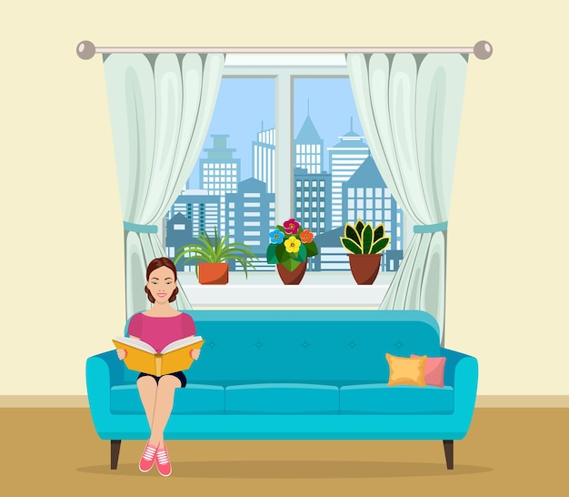 Young woman relaxing on sofa reading book at home