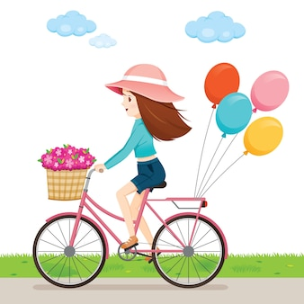 Young woman riding bicycle with flowers in front basket and balloon behind