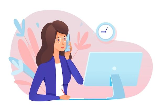젊은 여성 비서 응답 전화 전문 전문가 말하는 전화는 컴퓨터 모니터의 테이블 앞에 앉아