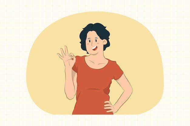 Молодая женщина, показывающая жест ок