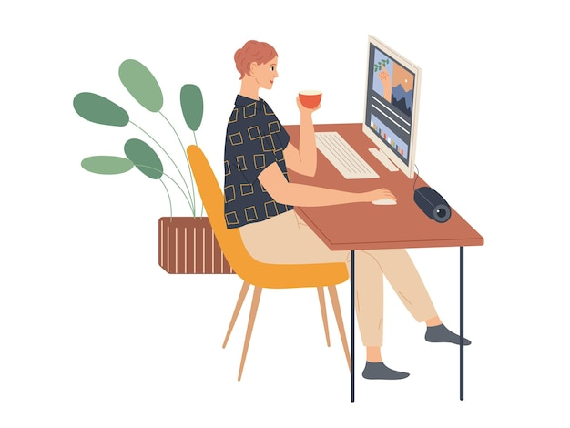 젊은여자가 앉아서 컴퓨터에서 작동합니다.