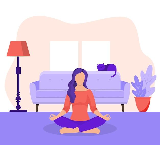 ヨガの蓮のポーズで座っている若い女性