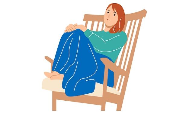 의자에 앉아 있는 젊은 여성