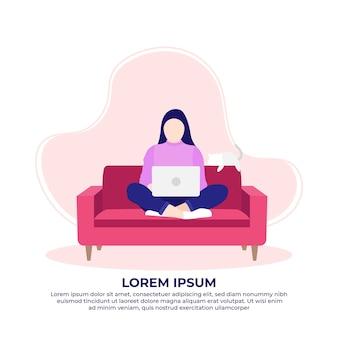 집에서 일하는 노트북을 사용하여 소파에 앉아 있는 젊은 여성