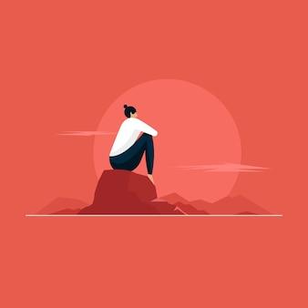 바위에 앉아 산 정상에서 경치를 즐기는 젊은 여성