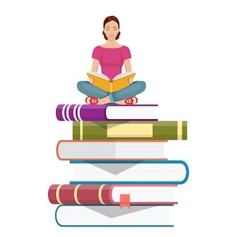 책의 더미에 앉아 젊은 여자