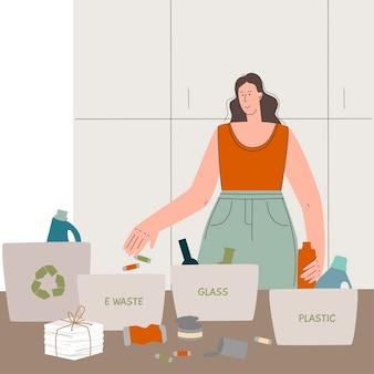 젊은 여성은 재활용을 위해 집에서 쓰레기를 분류하고 플라스틱 유리 전자 제품을 제로 폐기물로 분리합니다