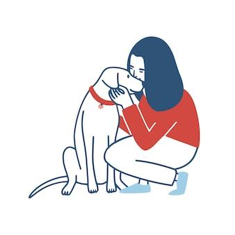 若い女性はしゃがんだ、抱擁し、彼女の犬にキスします