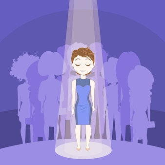 Young woman standing out crowd in spot light over silhouette people group background