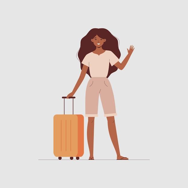 젊은 여성은 여행용 가방을 들고 서서 인사하며 손을 흔든다