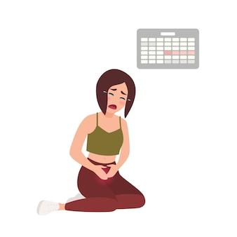 Молодая женщина страдает от болезненных менструаций