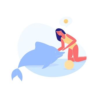Young woman swim caress dolphin in pool or sea