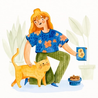 Giovane donna che si prende cura del gatto adorabile
