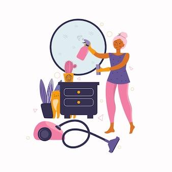 Молодая женщина убирает дом. уборка дома. любимые занятия дома. проводить время дома
