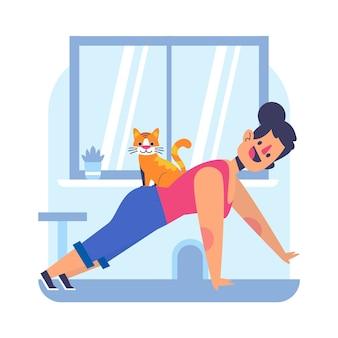 그녀의 고양이와 집에서 훈련하는 젊은 여자