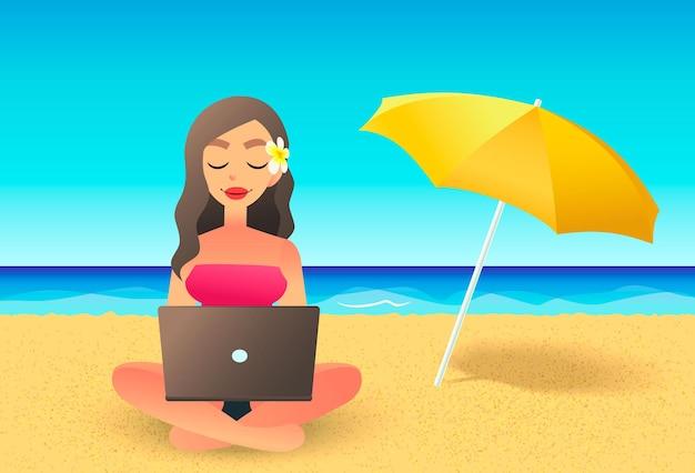 ビーチでラップトップコンピューターを使用して若い女性