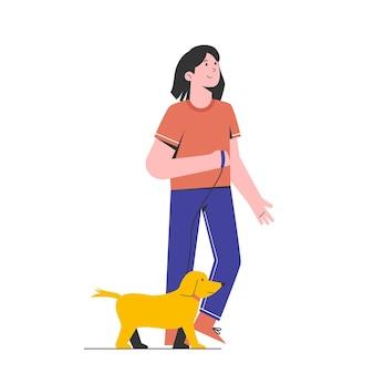 공원에 그녀의 강아지와 함께 산책하는 젊은 여자