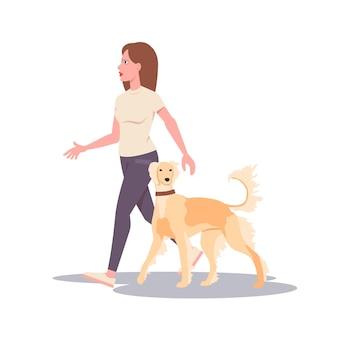 犬を連れて歩く若い女性