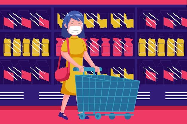 Молодая женщина гуляет с пустой тележкой в супермаркете с маской
