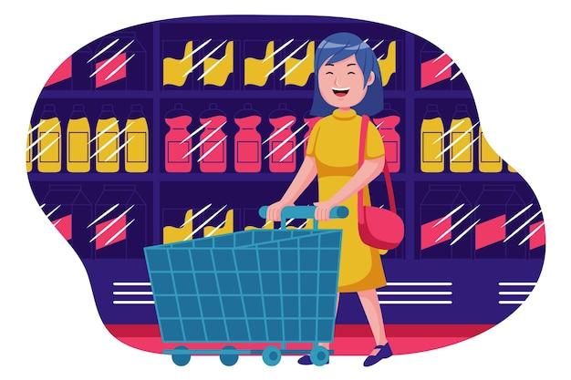 スーパーマーケットで空のトロリーと歩く若い女性