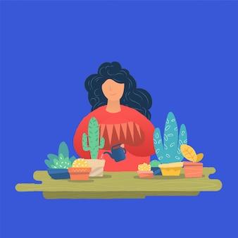 観葉植物に水をまく若い女性。