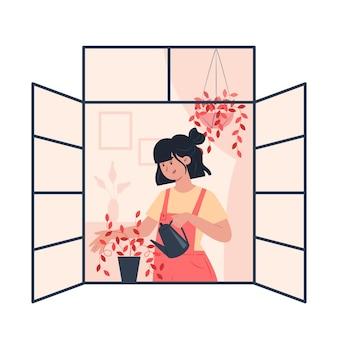 열린 창에 식물을 급수하는 젊은 여자