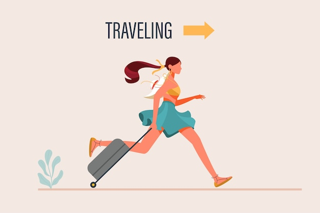 旅行かばんを持って歩くファッショナブルな服を着て若い女性