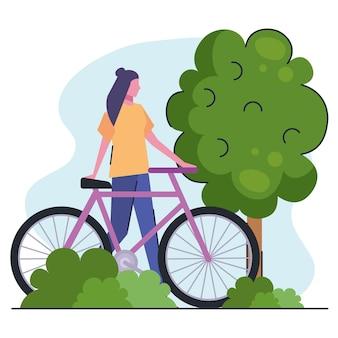 公園のイラストで自転車と若い女性