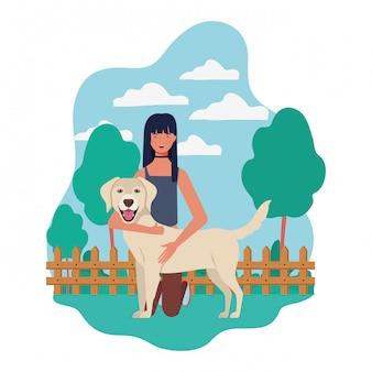 Молодая женщина с милой собакой в поле