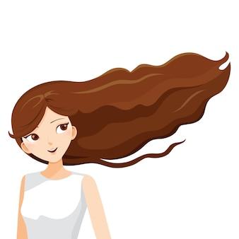 Молодая женщина с длинными каштановыми волосами, развевающимися на ветру
